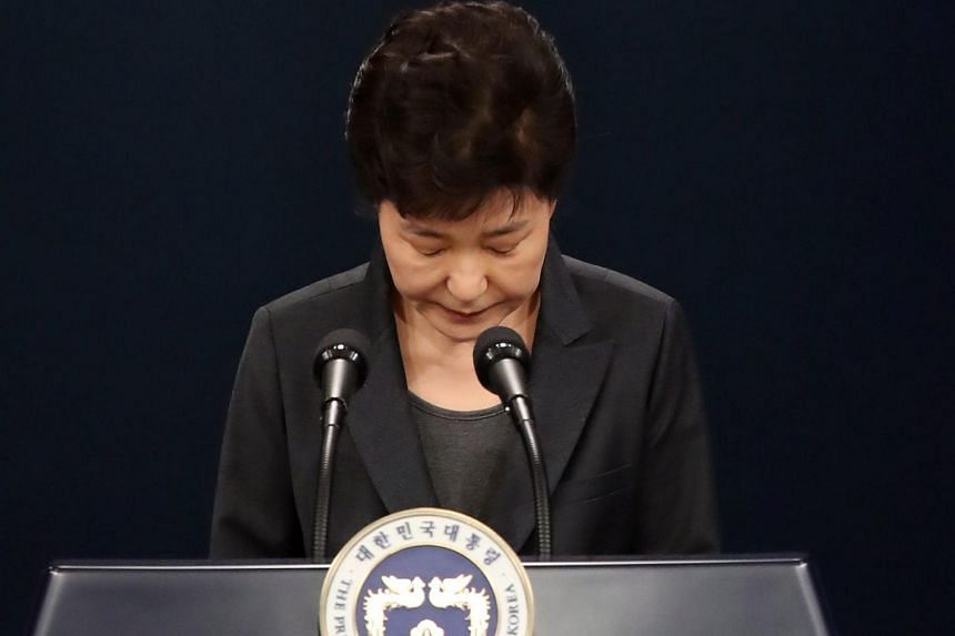 South Korean President Park Geun-hye bows in apology as she delivers an address to the nation at the presidential office on Nov 4, 2016.