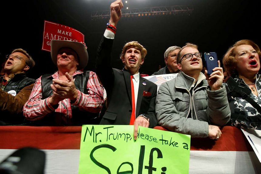 Supporters cheer as Republican presidential nominee Donald Trump attends a campaign rally in Manchester, New Hampshire.