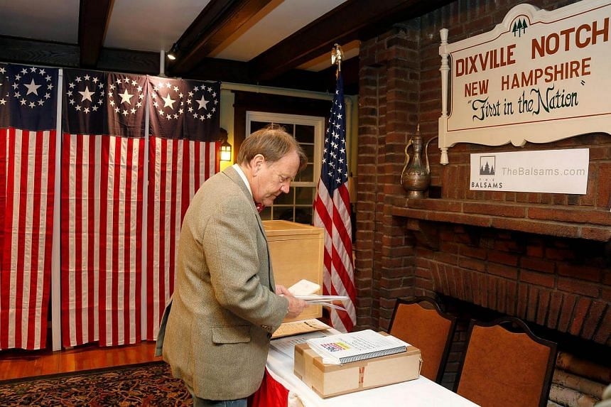 Town moderator Tom Tillotson arriving with the ballots for the US presidential election at midnight in Dixville Notch, New Hampshire, on Nov 7, 2016.