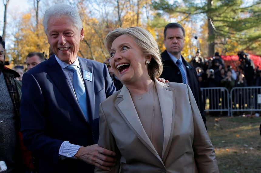 U.S. Democratic presidential nominee Hillary Clinton and her husband, former U.S. President Bill Clinton, talk to reporters after casting their ballots at the Douglas Grafflin Elementary School in Chappaqua, New York.
