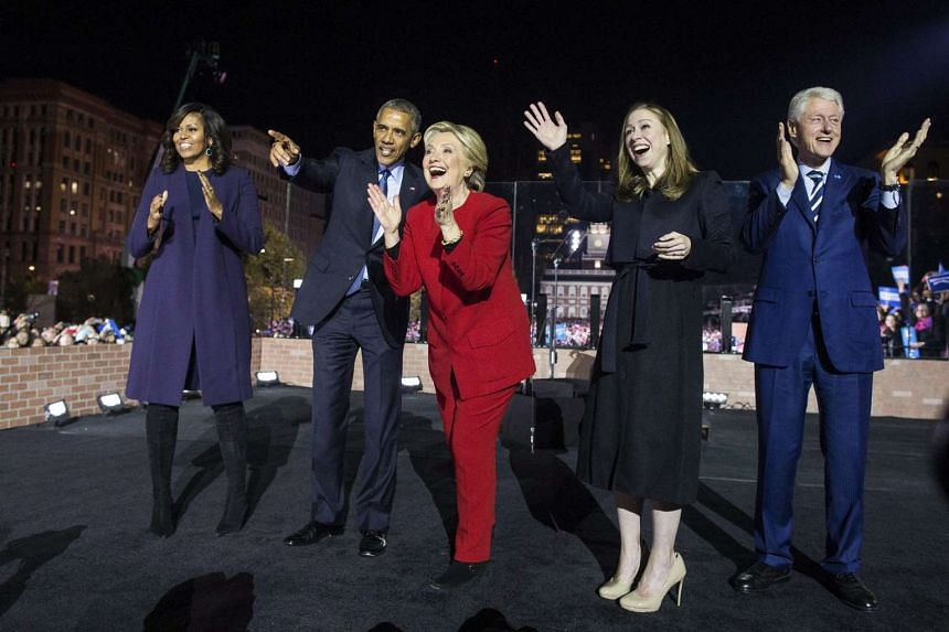 (From left) First lady Michelle Obama, President Barack Obama, Hillary Clinton, Chelsea Clinton and former President Bill Clinton at the conclusion of a campaign rally on Independence Mall in Philadelphia, on Nov 7, 2016.