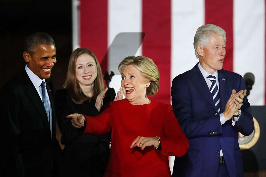 Democratic presidential nominee Hillary Clinton stands with President Barack Obama, former President Bill Clinton and daughter Chelsea during an election eve rally on Nov 7, 2016 in Philadelphia, Pennsylvania.