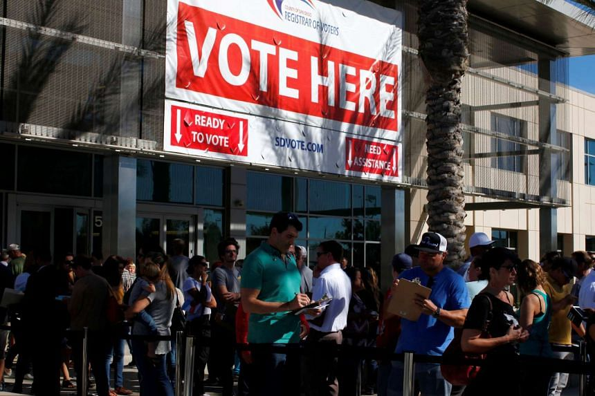 People line up to vote early outside the San Diego County Elections Office in San Diego.