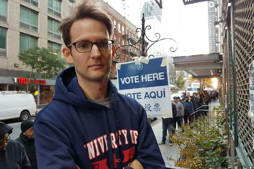 New York voter Sean Sullivan, 30, trader, who got in line at 6.30am to vote. He will be voting Democrat up and down the ballot today.