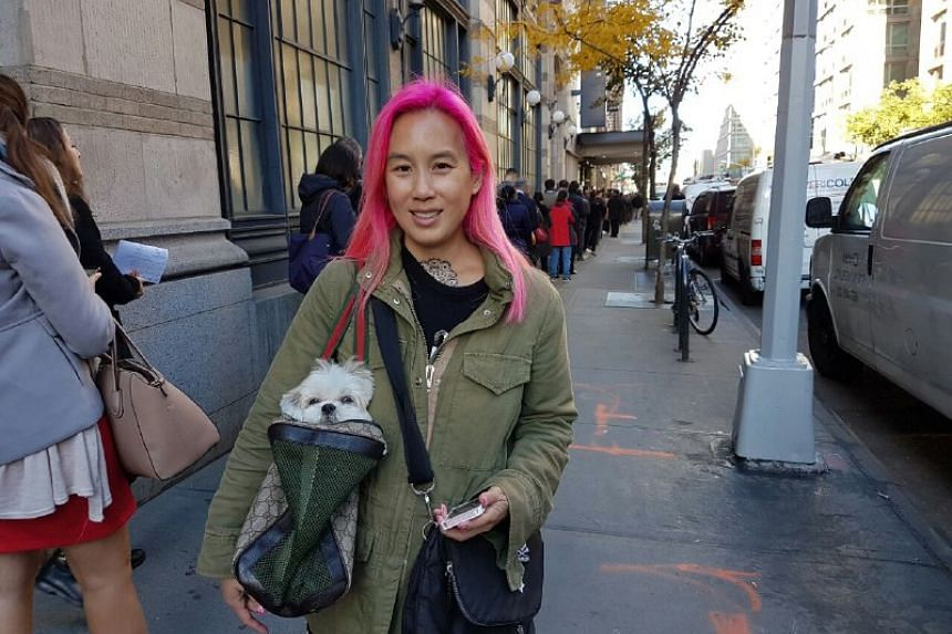 "Housewife Grace Yang, 47, who has been living in Paris for the past two months, flew back to the United States for two days just to vote. ""This election is historic, and I wanted to vote for Hillary. Donald Trump is just unacceptable,"" said the New Y"