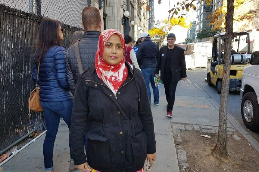 Ms Aklima Akter, 36, housewife, said she wasn't particularly affected by Mr Trump's comments about Muslims even though she is Muslim, but she believes people of all races and religions should be allowed to enter the country. Her vote is going to Hill