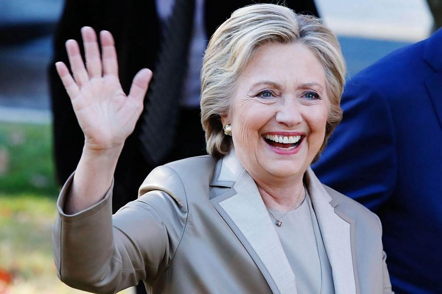 Presidential nominee Hillary Clinton greets supporters after casting her vote in Chappaqua, New York, on Nov 8, 2016