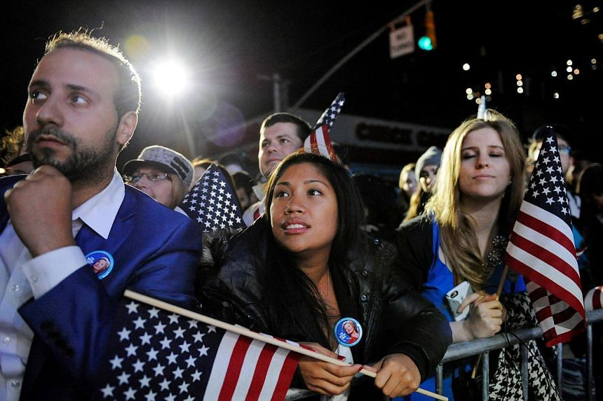 Supporters of US presidential nominee Hillary Clinton watch results come in from the overflow crowd outside the nominee's election night rally at the Jacob K. Javits Convention Centre in New York.