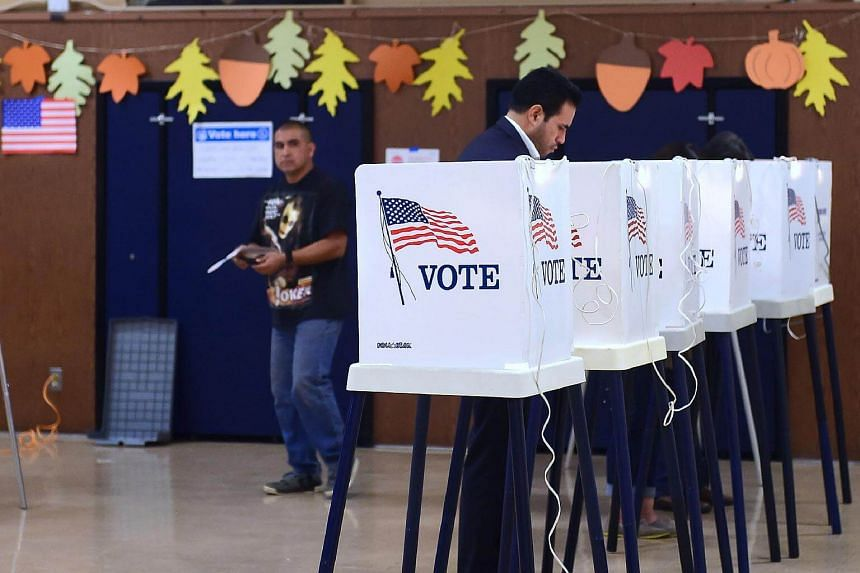 People vote on election day at Brooklyn Avenue Elementary School in the primarily Latino East Los Angeles neighbourhood of Boyle Heights on Nov 8, 2016.