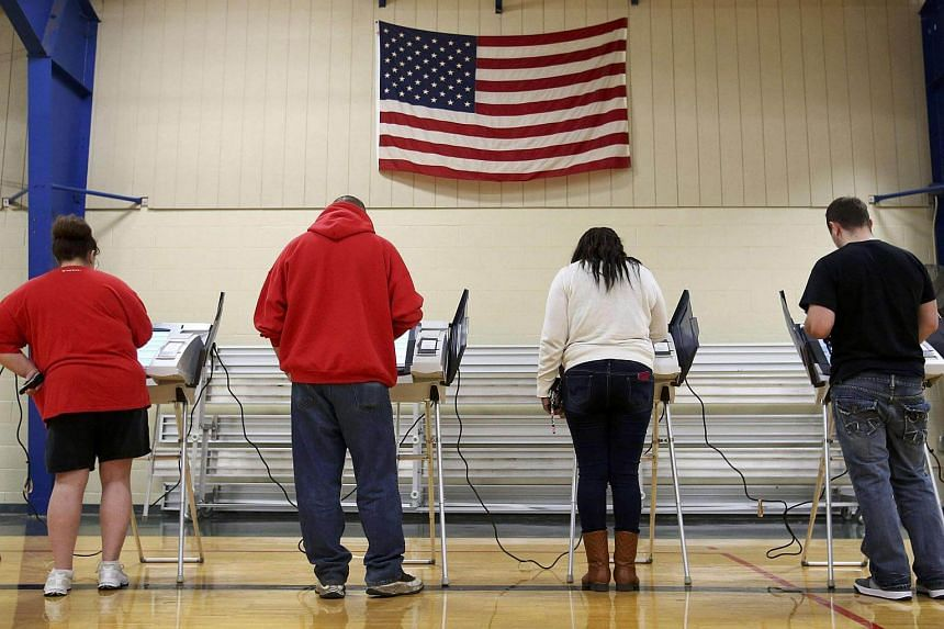 Voters cast their votes during the US presidential election in Elyria, Ohio.