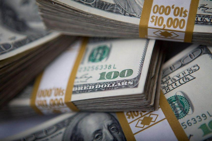 Stacks of US$100 bills. The United States dollar is sliding against key Asian currencies as anxieties rise over results pouring in from the nail-biting presidential elections.