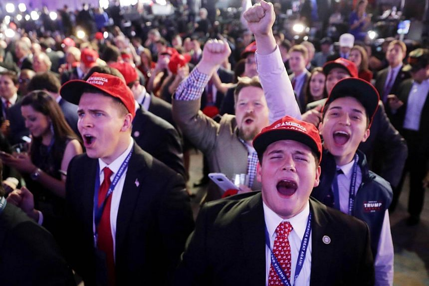 Supporters of Republican presidential nominee Donald Trump cheer during the election night event at the New York Hilton Midtown on Nov 8, 2016, in New York City.
