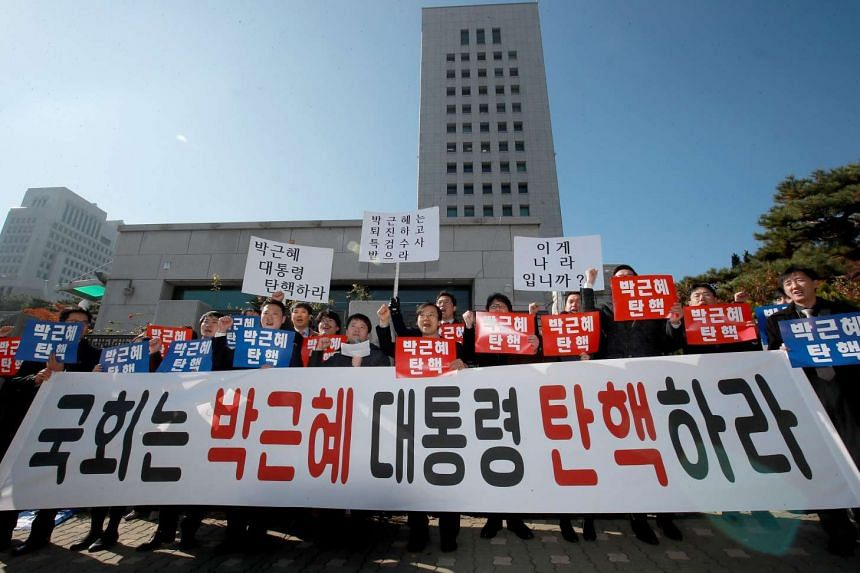 A group of lawyers hold a rally in front of the Supreme Prosecutors Office in Seoul on Nov 9, 2016 to demand the resignation of South Korean President Park Geun Hye.