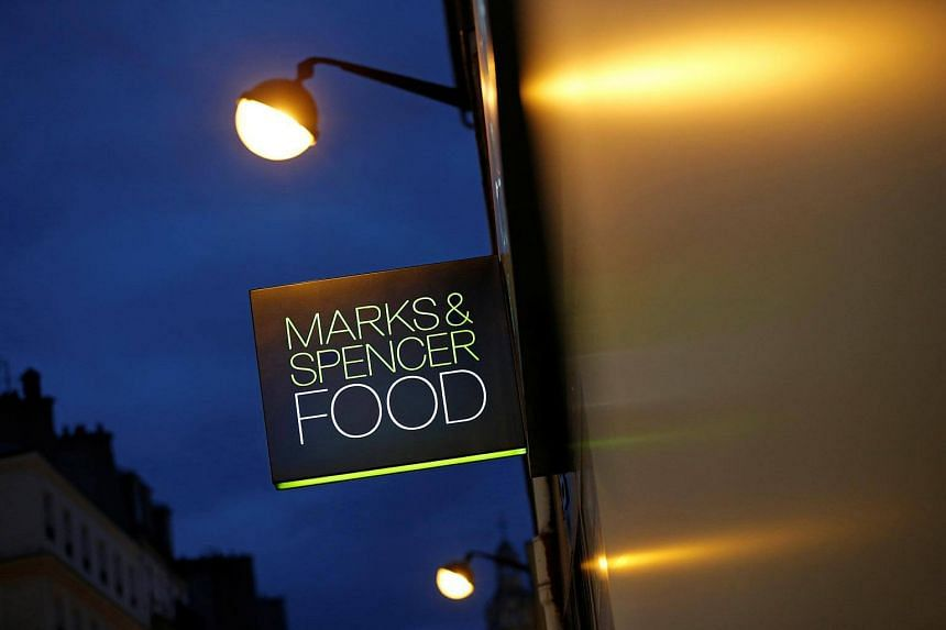 A Marks & Spencer logo is seen in front of one of their food stores in Paris, France on Nov 8, 2016.