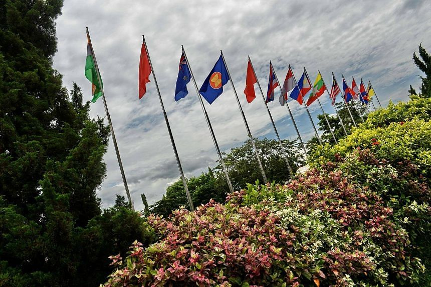 Flags from Asean countries and partners flutter outside the Asean media centre during the 28th Association of Southeast Asian Nations (Asean) Summit.