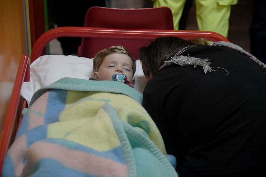 A child sleeps in a secured area after earthquakes in the village of Visso, central Italy, on Oct 26, 2016.
