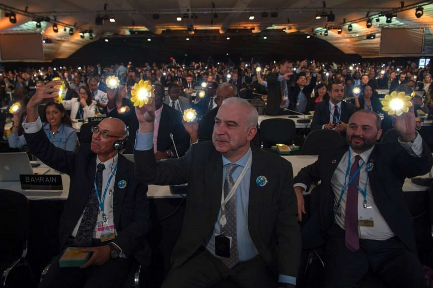 Delegates attend the opening session of the COP22 climate talks in Marrakesh on Nov 7, 2016.