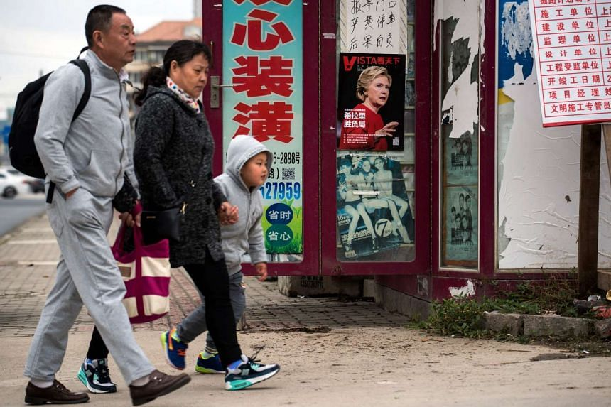 A magazine cover with US presidential candidate Hillary Clinton is displayed at a newsstand in Shanghai, on Nov 8, 2016.