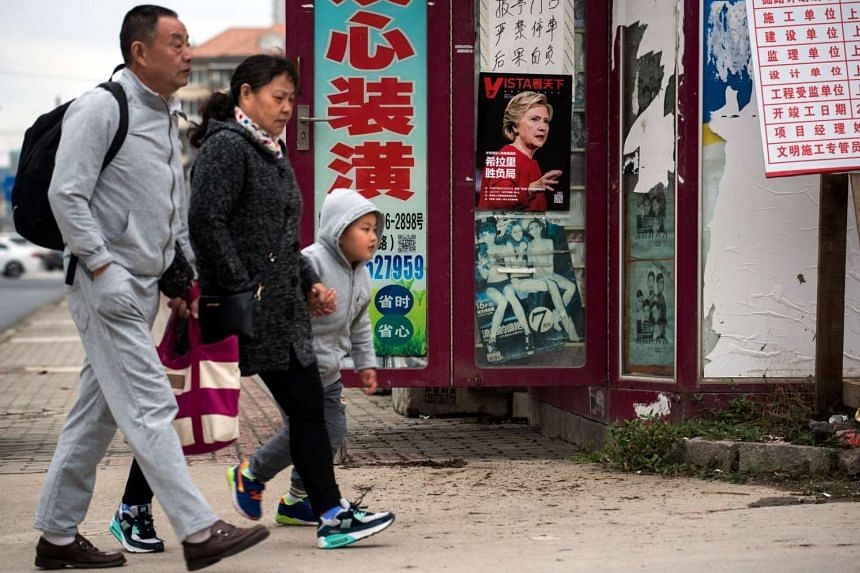 A magazine cover with US presidential candidate Hillary Clinton is displayed at a newsstand in Shanghai on Nov 8, 2016.