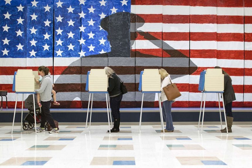 Voters cast their ballots at Robious High School on Election Day in Ashland, Virginia.