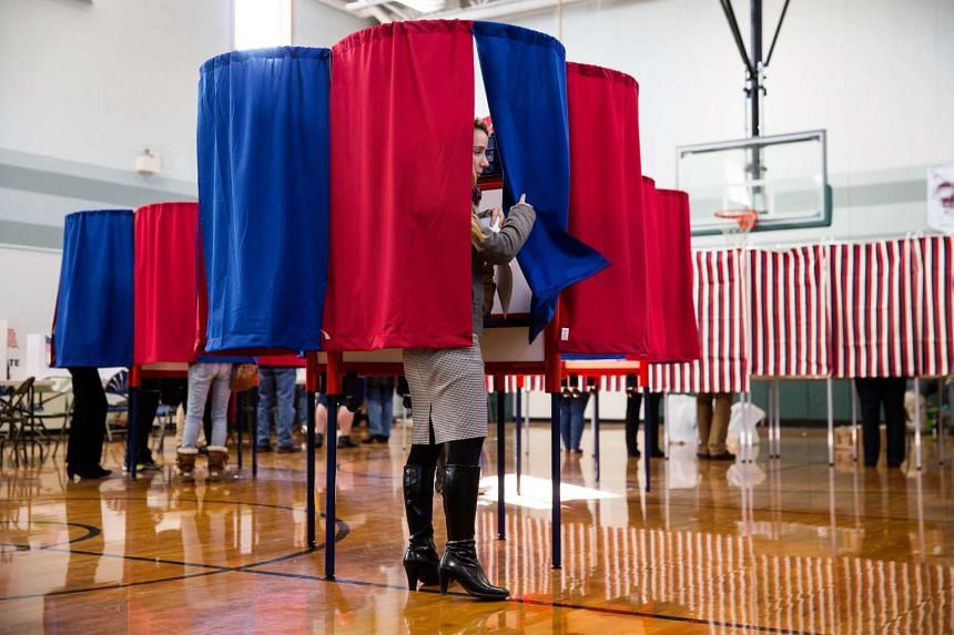 New Hampshire citizens casting their vote at Amherst Street Elementary School on Nov 8, 2016, in Nashua, New Hampshire.