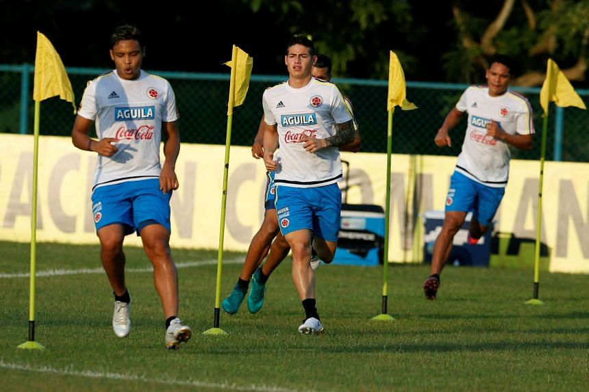 Colombia's James Rodriguez (centre) and his team mates attend a training session.