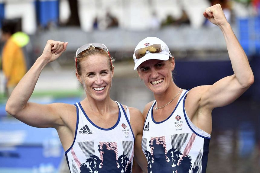 British rowers Heather Stanning (right) and Helen Glover celebrating after winning gold in the Women's Pair event during the Rio Olympics on Aug 12, 2016.