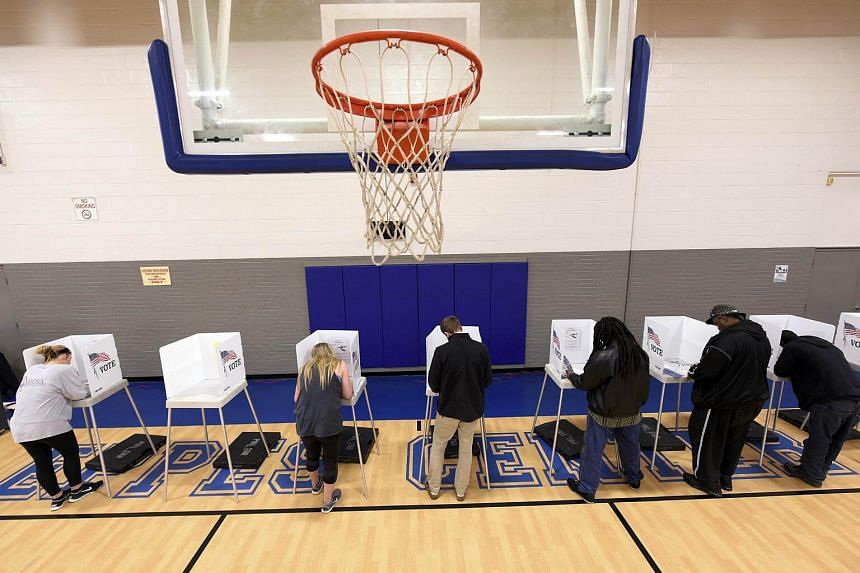 Citizens vote at a recreation centre in Greenville, North Carolina, during the US general election on Nov 8, 2016.