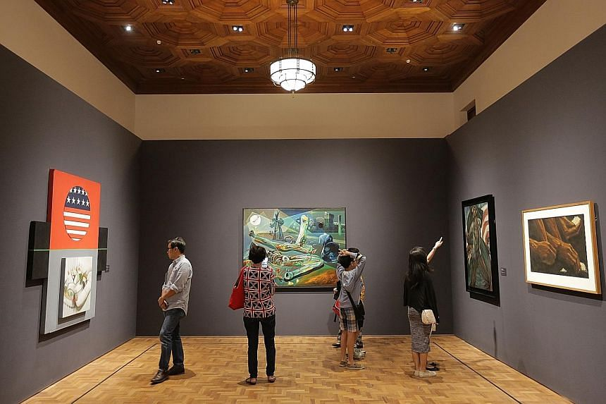 Visitors viewing the artworks at the National Gallery Singapore. More than 60 activities, including a light show on the facade of the museum, will be held as part of its first anniversary celebrations.