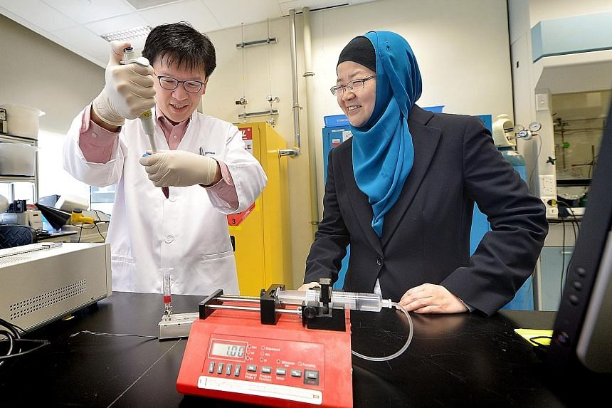 "Left: IBN's team leader and principal research scientist Dr Tan, with executive director ProfYing. Above: A ""microdevice"" which draws blood samples through a tiny custom-made sieve."