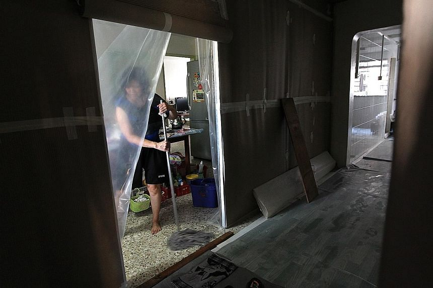 Residents of Block 36, Bedok South Avenue 2, had to put up with noise, dust and inconvenience for 10 days as improvement works to their toilets and bathrooms were carried out. Built in 1977, their block is included in the Home Improvement Programme,