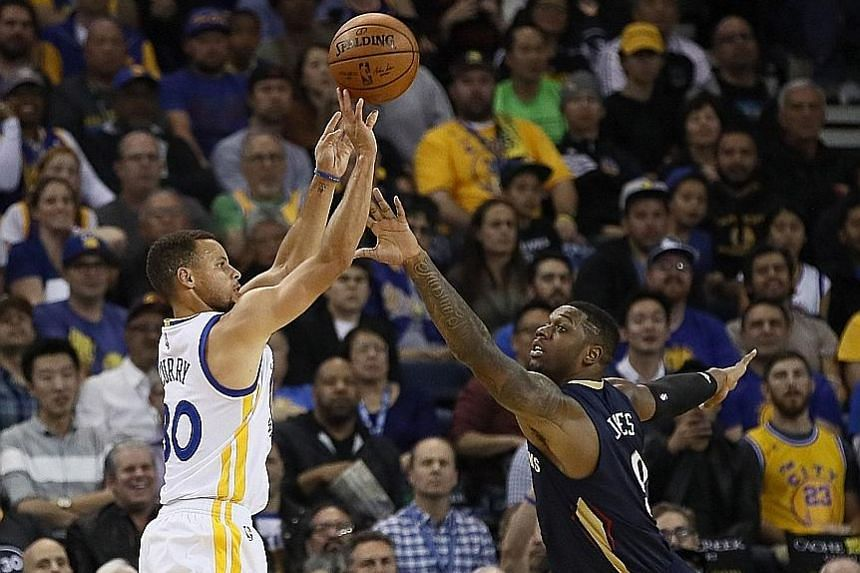 Warriors guard Stephen Curry shoots a three-pointer over Pelicans forward Terrence Jones in Golden State's 116-106 win at Oracle Arena. Curry had 46 points.