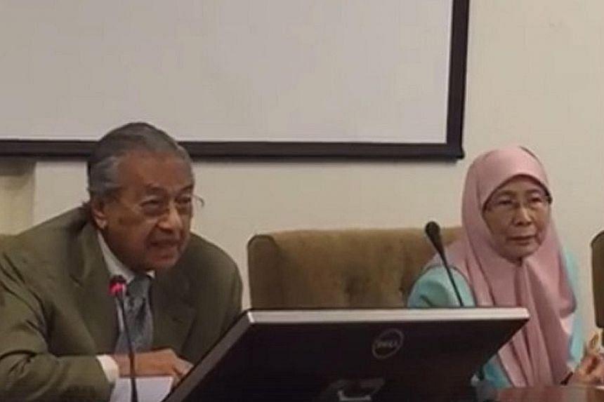 Dr Mahathir was seated next to Dr Wan Azizah at the press conference yesterday. They nodded to each other but did not speak to each other - a reflection of 18 years of bad blood between the former prime minister and the Anwar family.