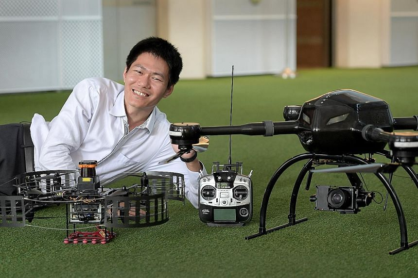 Dr Wang with his firm's BlackLion-068 (left) and BlackLion-168 (right) unmanned aerial vehicles.