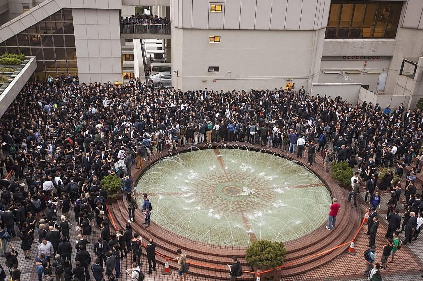 Members of Hong Kong's legal community and law students from the University of Hong Kong gather outside the city's High Court during a silent march. The move to interpret the Basic Law has sparked fears that China is tightening its grip on the city a