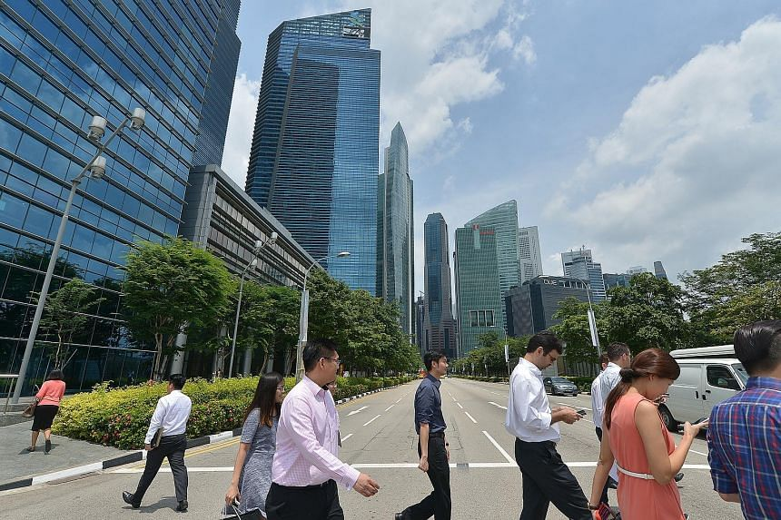 Singapore's central business district. Among the questions and points that MPs put to Manpower Minister Lim Swee Say yesterday was one suggesting that MOM work closely with unions and bosses to reduce the number of job mismatches. Mr Lim agreed, sayi