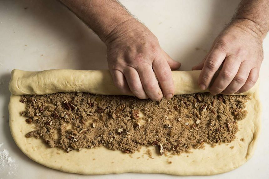 A rich filling of pecans, brown sugar, cinnamon and raisins is rolled in a rich yeasted dough for pecan rolls.