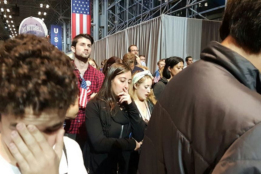 Clinton supporters reacting to news that Trump has won North Carolina.