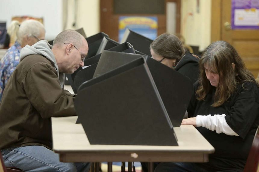 Voters fill out their ballots at St Lawrence Catholic Church in Cincinnati, Ohio, during the US presidential election on Nov 8, 2016.