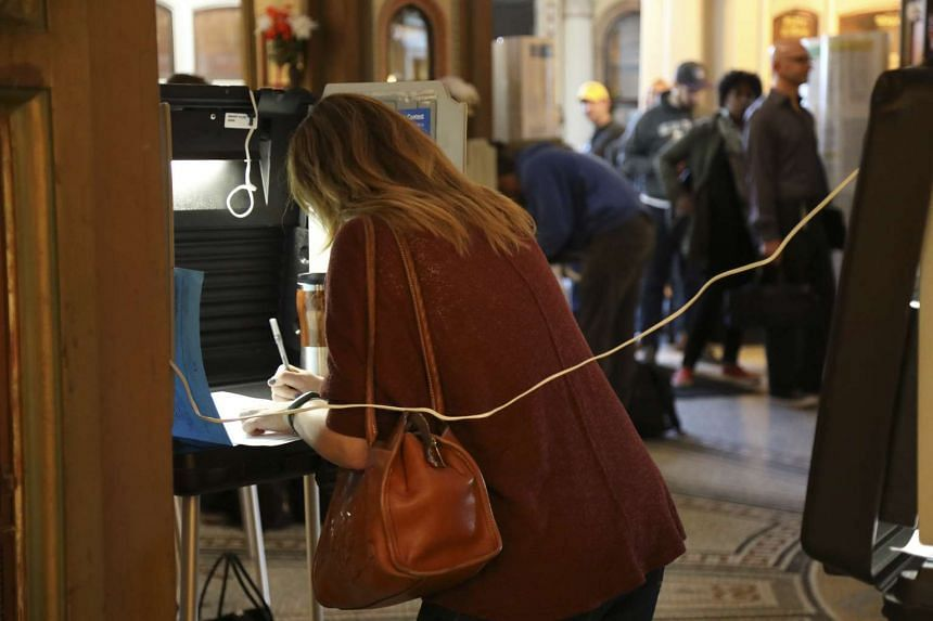Natalie Strickler fills out her ballot on election day at the San Francisco Columbarium on November 8.