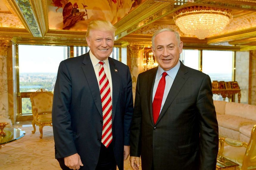 Israeli Prime Minister Benjamin Netanyahu (right) stands next to Donald Trump during their meeting in New York on Sept 25, 2016.