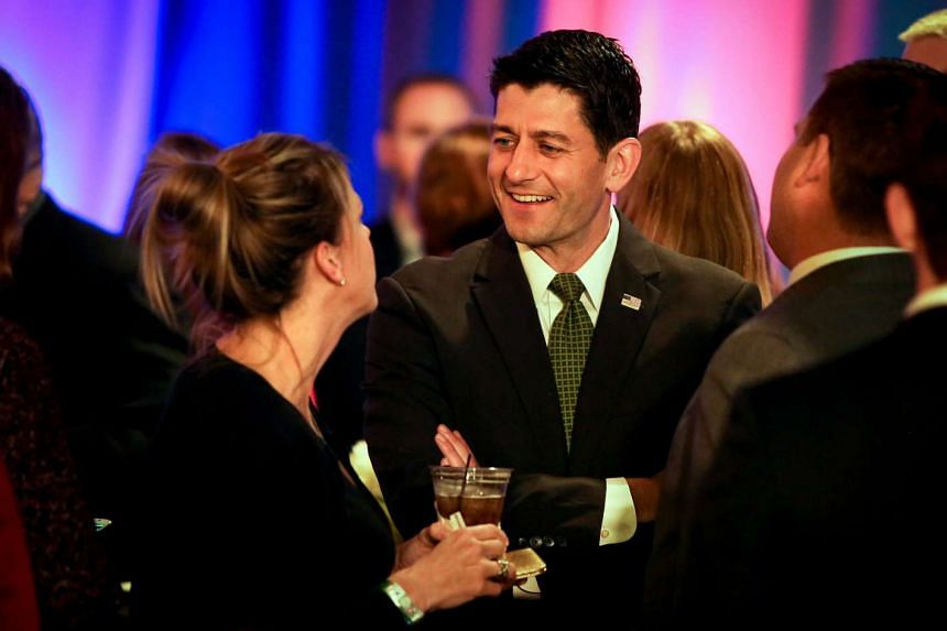 US Speaker of the House Paul Ryan speaks with an attendee during an Election Night event in Janesville, Wisconsin on Nov 8, 2016.
