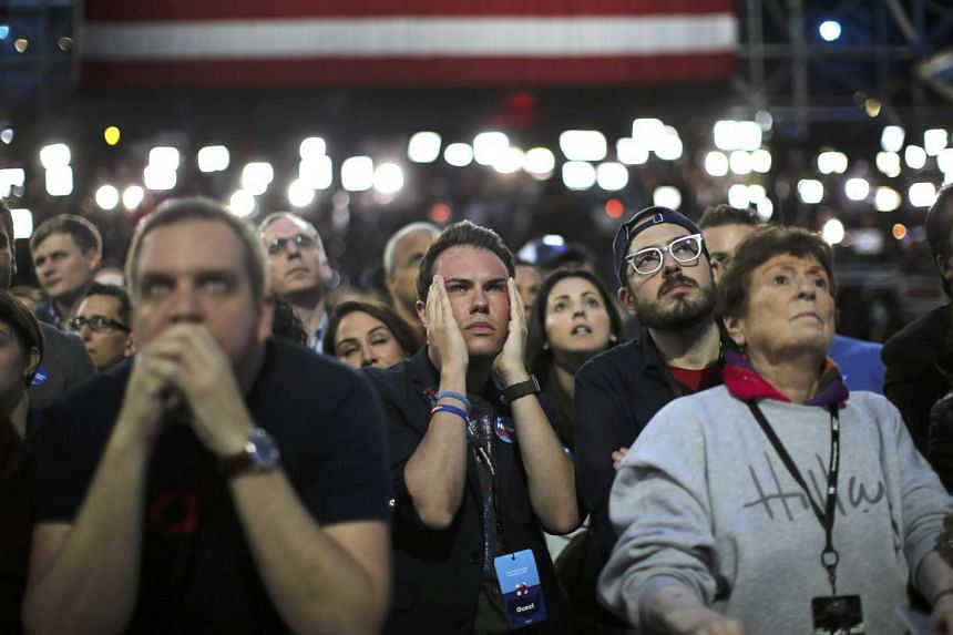 Supporters of Democratic presidential nominee Hillary Clinton watch and wait at her election night rally in New York on Nov 8, 2016.