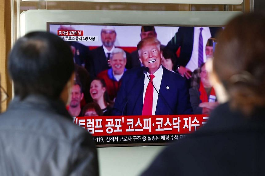 South Koreans watching the US presidential elections at a station in Seoul on Nov 9, 2016.