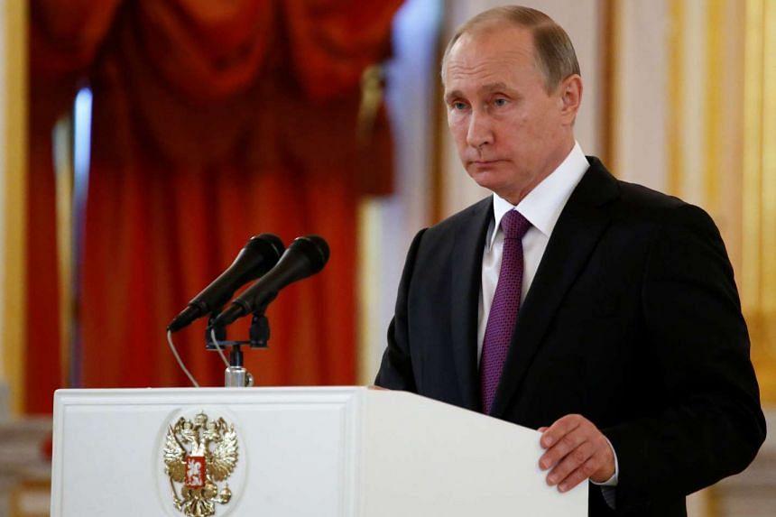 Russian President Vladimir Putin speaking at the Kremlin in Moscow on Nov 9, 2016.