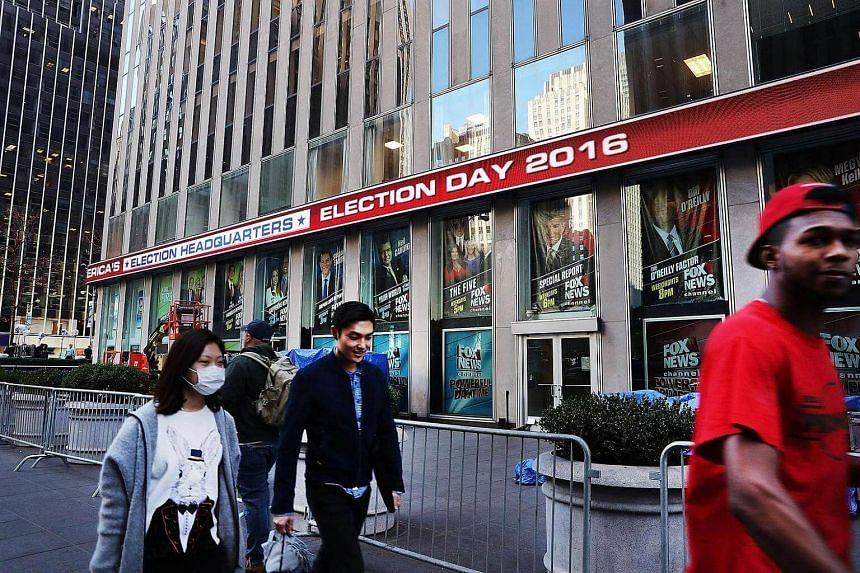 People walk through midtown Manhattan on Election Day on Nov 8, 2016, in New York City.