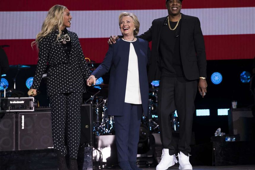 Beyonce, Hillary Clinton and Jay Z at a campaign concert in Cleveland, Ohio on Nov 4 where the pop star wore a pantsuit.