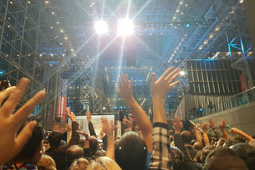 "At the Jacob Javits Center in New York, many of Mrs Hillary Clinton's supporters are taking photos of the ""glass ceiling"" under which Mrs Clinton will greet her supporters later tonight."