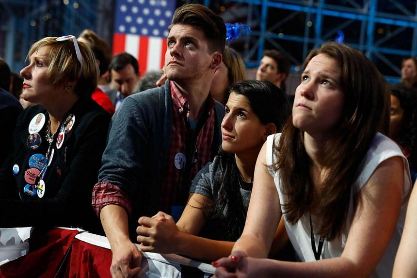 People watch voting results at Democratic presidential nominee Hillary Clinton's election night event at the Jacob K. Javits Convention Centre in New York City on Nov 8, 2016.