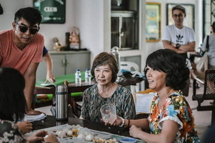 Aileen Tan (right) and Li Yinzhu (second from right) and local filmmaker, Royston Tan (left, with dark glasses) on the set of Eat Already?.